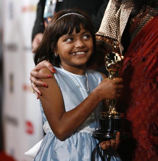 """<b>23. 2. - Oscarový slum</b> - Příběh mladíka, který vyhraje indickou verzi soutěže Chcete být milionářem, a musí dokázat, že nepodváděl, zaujal americkou akademii nejvíce.Snímek Milionář z chatrče to dotáhl z bombajského slumu až k osmi Oscarům.<br>Získal sošky za nejlepší film a nejlepší režii pro Dannyho Boylea a stal absolutním vítězem 81. ročníku udílení cen Americké filmové akademie.<br>Na snímku je jedna z hlavních protagonistek snímku Rubina Ali.<br><b>Další podrobnosti si </b><A href=""""http://aktualne.centrum.cz/zpravy/clanek.phtml?id=630293""""><b>připomeňte ve článku zde</b></A>"""